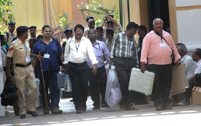 Polling personnel leave for their respective booths on the eve of by polls to the Panaji Assembly that fell vacant after the then MLA and current Union Defence Minister Manohar Parrikar ... - Manohar Parrikar