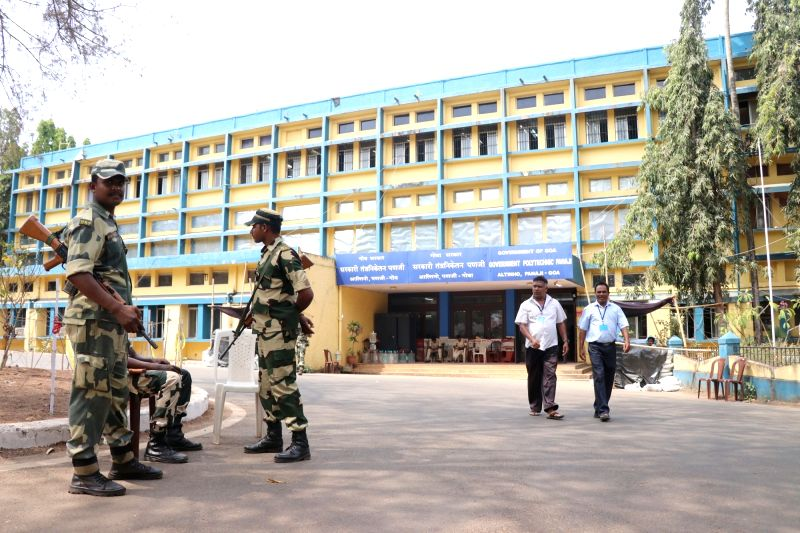 Panaji: Security personnel stand guard outside EVM strongroom at Government Polytechnic College on the eve of the counting of votes for the 2019 Lok Sabha elections, in Panaji on May 22, 2019.