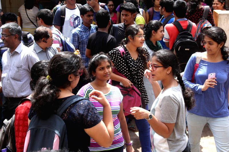 Students discuss question paper after coming out of examination hall in Panaji, on March 2, 2015. CBSE board exams commenced today.