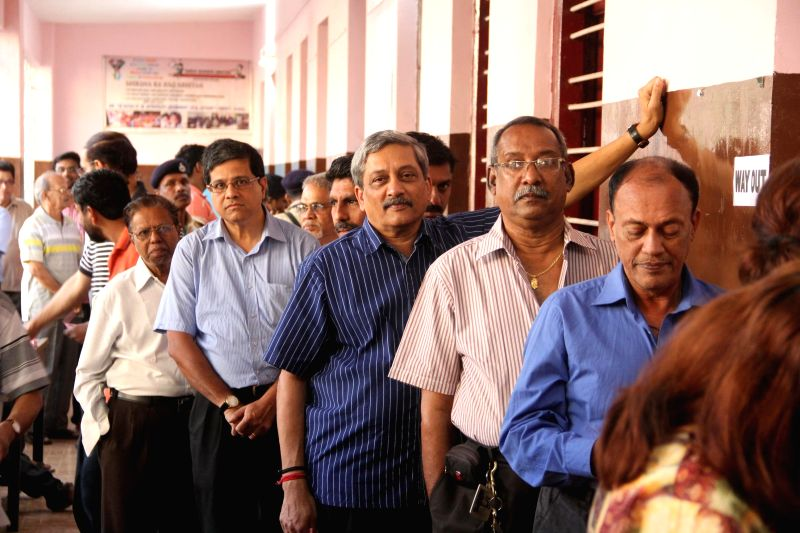 Union Defence Minister Manohar Parrikar stands in a queue to cast his vote during the by polls to the Panaji Assembly that fell vacant after he resigned from the seat to assume his current ... - Manohar Parrikar