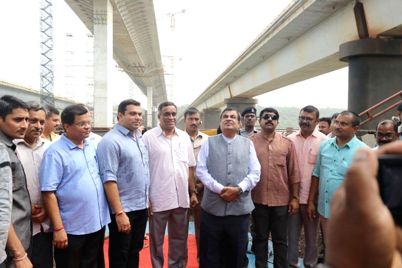 :Panaji: Union Transport Minister Nitin Gadkari inspects the ongoing construction of Mandovi bridge along with BJP MP Narendra Savoikar, Goa Ministers Rohan Khaunt, Sudin Dhawlikar and Vijai ...
