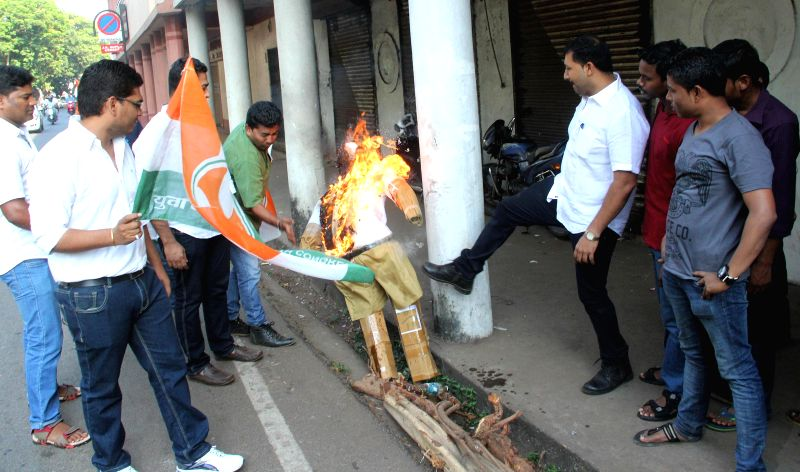 Youth Congress activists burn an effigy of RSS chief Mohan Bhagwat to protest against his remarks on Mother Teresa in Panaji on Feb 26, 2015.