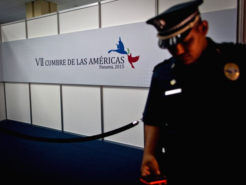 A security guard uses his cellphone in the press work room of the Seventh Summit of the Americas in Panama City, capital of Panama, April 9, 2015. The Seventh ...