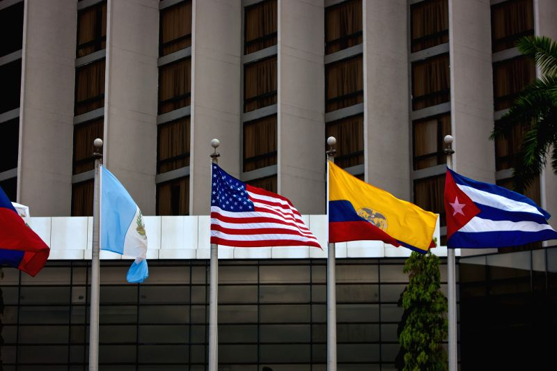 The U.S. national flag and the Cuban national flag are seen at the venue of the seventh Summit of the Americas in Panama City of Panama, April 9, 2015. ...