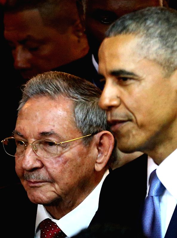 Image provided by Peru's Presidency shows U.S. President Barack Obama (R) and Cuba's President Raul Castro before the opening of the 7th Summit of the ...