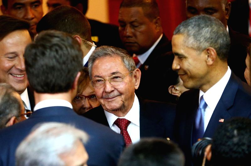 Image provided by Peru's Presidency shows U.S. President Barack Obama (R) and Cuba's President Raul Castro (C) before the opening ceremony of the 7th Summit of ...