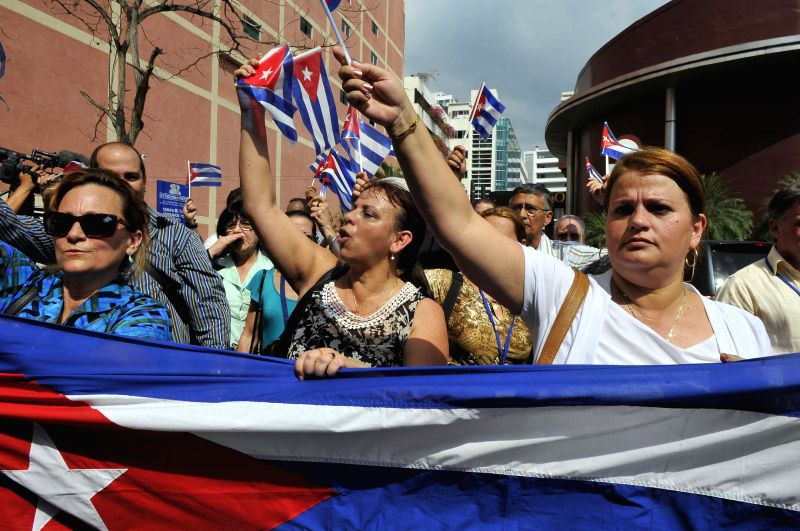 People attend a march in support of Cuba ahead of the seventh Summit of the Americas in Panama City, capital of Panama, on April 10, 2015. The seventh Summit ...