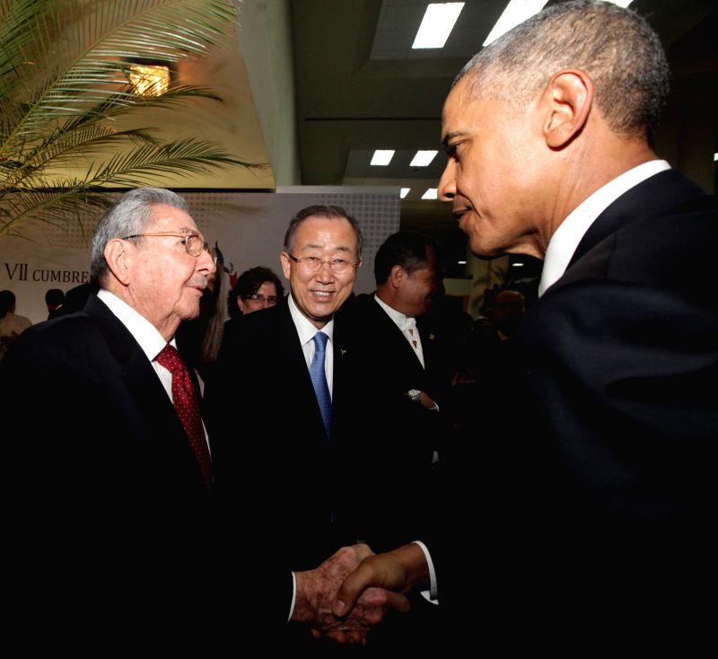 U.S. President Barack Obama (R) shakes hands with Cuban leader Raul Castro as United Nations Secretary-General Ban Ki-moon looks on before the opening of the ...