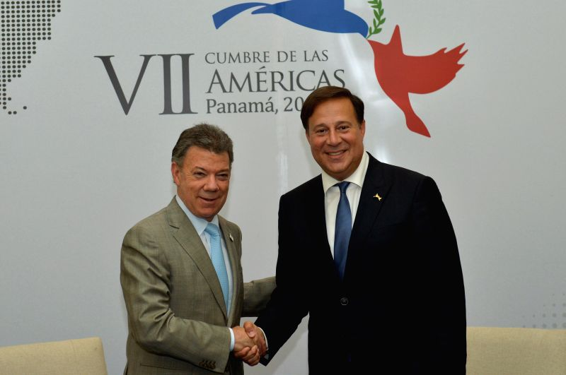 Image provided by Colombia's Presidency shows Colombian President Juan Manuel Santos (L) meeting with Panamanian President Juan Carlos Varela during the 7th ...