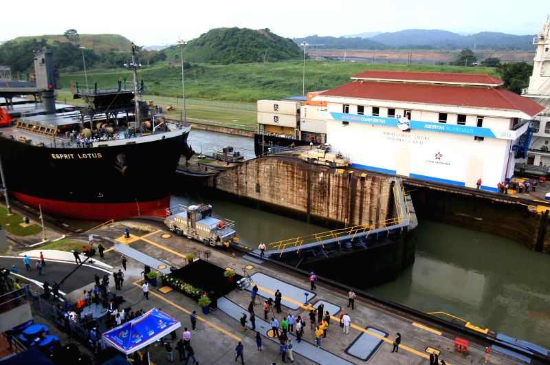 A ship passes through the locks during the commemoration of the 100th anniversary of the Panama Canal, at the Miraflores Locks, in Panama City, capital of ...