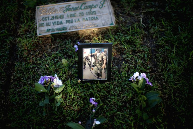 A photograph remains on a grave in a ceremony held in honor to the death during the United States invasion of Panama on Dec. 20, 1989, in Panama City, capital ..
