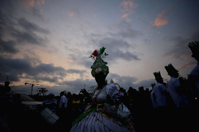 A dancer takes part in a parade as part of the celebrations of the Carnival, in Panama City, capital of Panama, on Feb. 14, 2015. (Xinhua/Mauricio ...