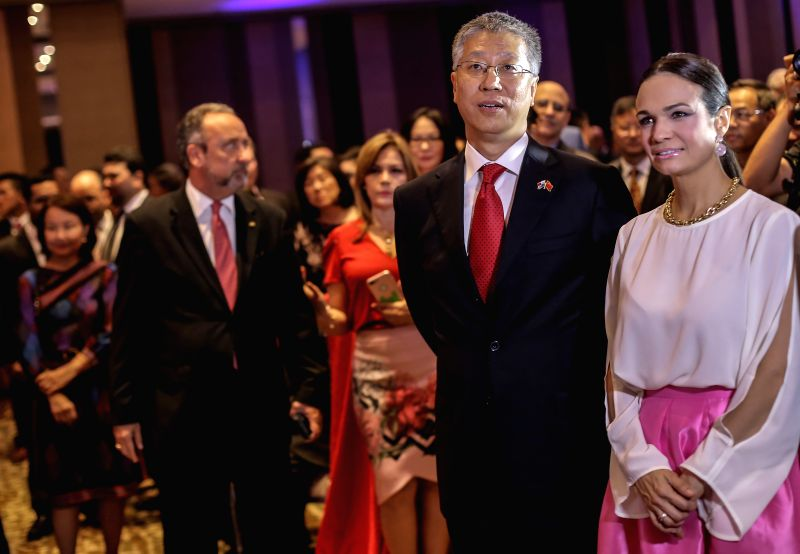 PANAMA CITY, June 14, 2018 - Photo taken on June 13, 2018 shows Chinese Ambassador to Panama Wei Qiang (2nd R) and Panamanian Vice President Isabel de Saint Malo (R) taking part in an event held to ...