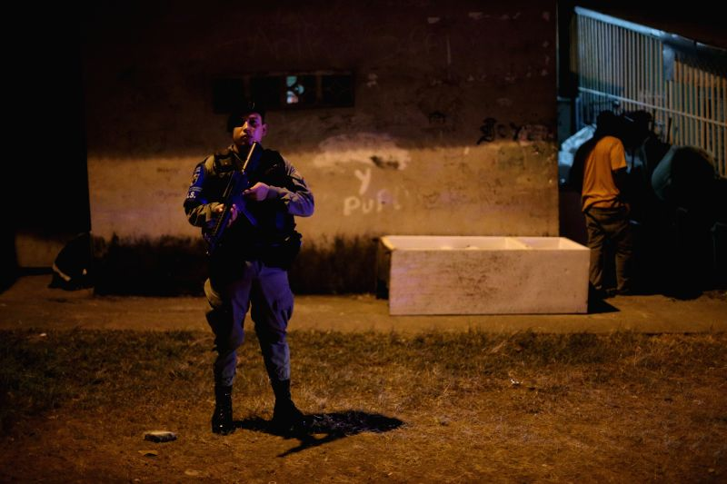 A member of National Police participates in an operation in San Joaquin Sector of Panama City, capital of Panama, on March 6, 2015. According to local press, ...