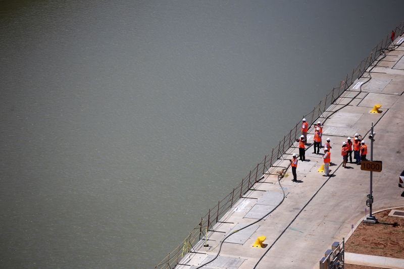 PANAMA CITY, May 12, 2016 - Workers stand on the platform of the expanded Panama Canal project in the Pacific sector, in Panama City, capital of Panama, on May 11, 2016. China COSCO Shipping line's ...