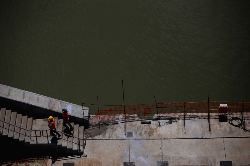 PANAMA CITY, May 12, 2016 - Workers walk on the platform of the expanded Panama Canal project in the Pacific sector, in Panama City, capital of Panama, on May 11, 2016. China COSCO Shipping line's ...