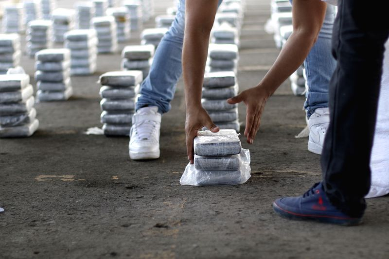 PANAMA CITY, May 31, 2016 - A member of the National Police arranges packages of drugs confiscated in different operatives, during a press conference in Panama City, capital of Panama, on May 30, ...