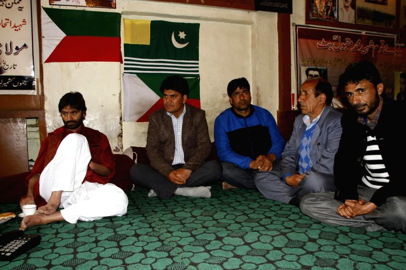 Panchs and Sarpanchs of the villages of Jamuu and Kashmir meet JKLF  chairman Mohmmad Yasin Malik in Srinagar on May 14, 2014.