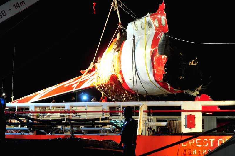 The tail part of crashed AirAsia flight QZ8501 is transferred from Crest Onyx ship in the port of Kumai, Pangkalan Bun, Indonesia, Jan. 11, 2015. ...