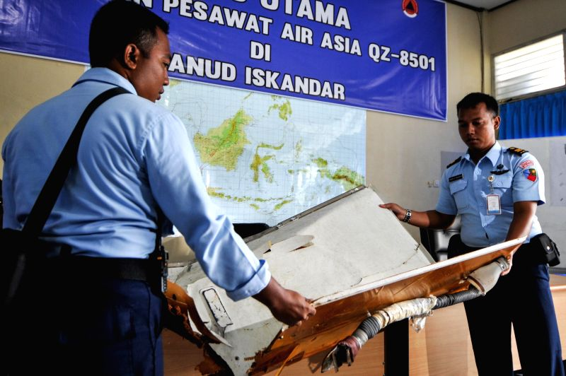 TNI officers show the debris of AirAsia flight QZ8501 which was found in the Karimata strait at Iskandar Air Base, Pangkalan Bun, Central Kalimantan, ...