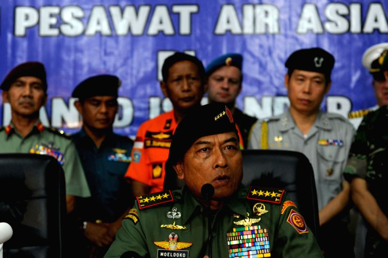 Indonesian Military Commander General Moeldoko (front) speaks during a press conference after joining in the search of Airasia QZ 8501 victims in Pangkalan ...