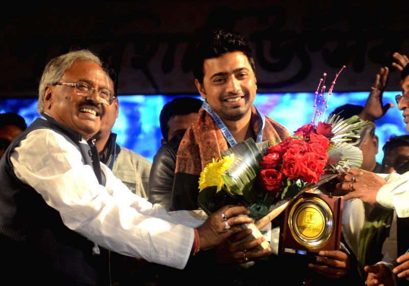 Actor and MP Dev being felicitated during a programme in Panihati of West Bengal on Dec 21, 2014.