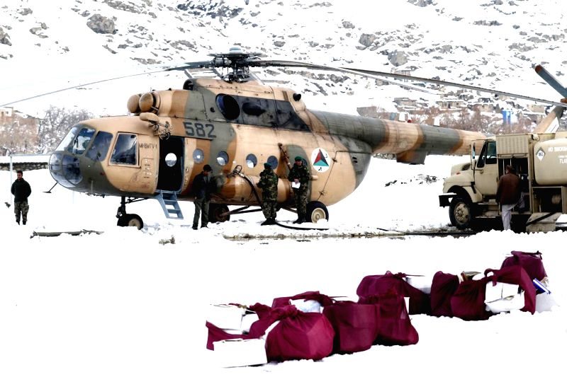 An Afghan army helicopter delivers aid for the victims of avalanches close to the avalanches site in Panjshir province, east Afghanistan, Feb. 28, 2015. The death ...