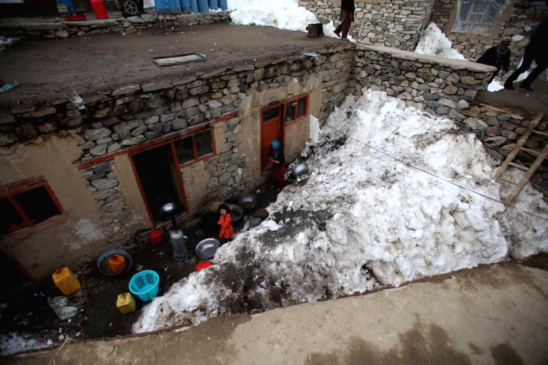 People live in their avalanche-affected house in Abdullah Khil of Panjshir, Afghanistan, March 1, 2015. Afghan government and scores of aid agencies have stepped ...