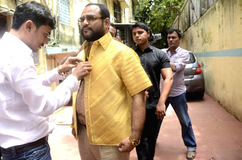 Pankaj Parakh, a Nashik based businessman wears a shirt made-up of 4 kg pure gold costing Rs 1.30 crore during his visit to Siddhivinayak Temple in Mumbai on Aug 5, 2014.