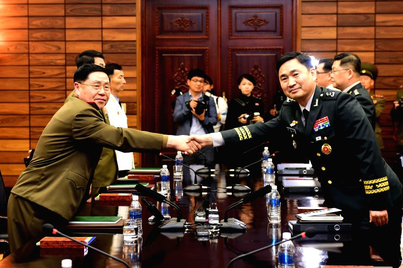 PANMUNJOM, June 14, 2018 - Lt. Gen. An Ik-san (L front) of the Democratic People's Republic of Korea (DPRK) shakes hands with Maj. Gen. Kim Do-gyun, a senior-level official of the defense ministry in ...