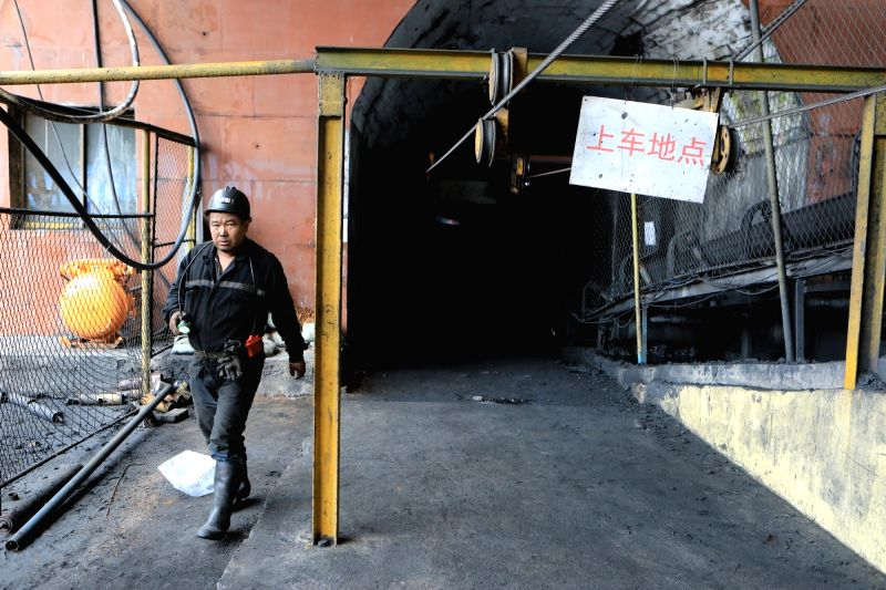 PANZHOU, Aug. 7, 2018 - A rescuer walks out of the accident site after a coal and gas outburst happened at Zimujia coal mine in Panzhou City, southwest China's Guizhou Province, Aug. 7, 2018. Four ...