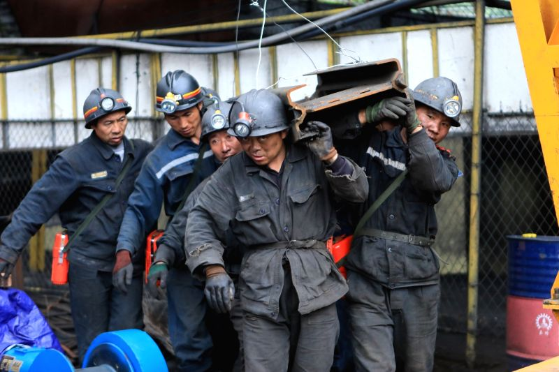 PANZHOU, Aug. 7, 2018 - Rescuers carry supplies at the accident site after a coal and gas outburst happened at Zimujia coal mine in Panzhou City, southwest China's Guizhou Province, Aug. 7, 2018. ...