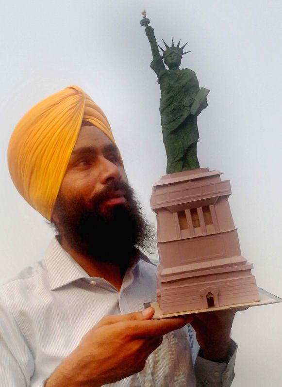 Paper Artist Gurpreet Singh shows a replica of Statue Of Liberty on 238th American Independence Day in Amritsar on July 4, 2014. - Gurpreet Singh