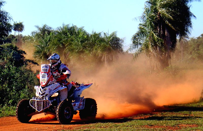 Peruvian pilot Alexis Hernandez, of the AH Racing team, takes part in the fist leg of the Guarani Challenge of the Dakar Series, in the Paraguari department, ...