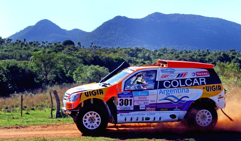 Pilots Juan Manuel Silva and Carlos Eduardo Lopez, take part in the fist leg of the Guarani Challenge of the Dakar Series, in the Paraguari department, 200km away