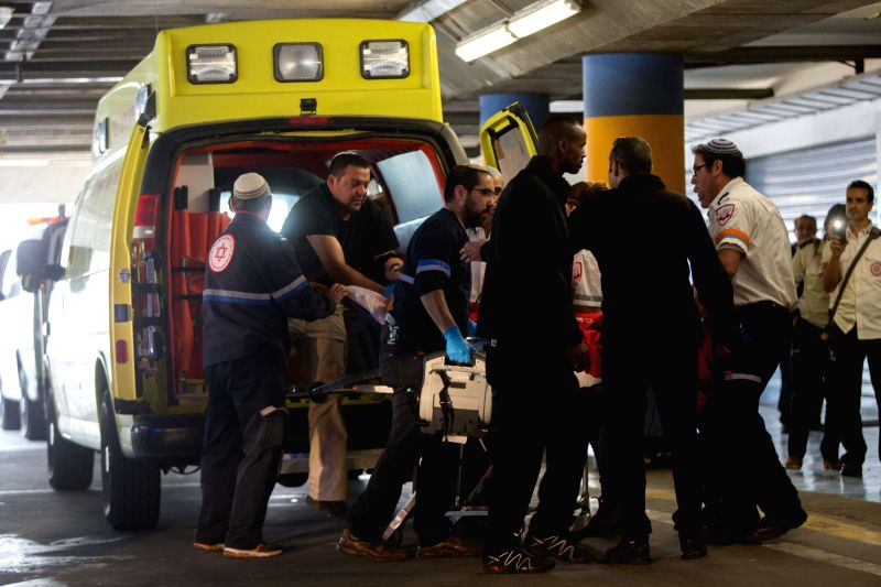 Paramedics wheel a wounded Israeli man into the emergency room of the Shaare Zedek Medical Center in Jerusalem, after he was stabbed by a Palestinian attacker ...