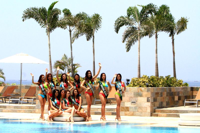 A candidate sits on the poolside during the Miss Philippines-Earth presentation in Paranaque City, the Philippines, on April 22, 2014. In observance of ...