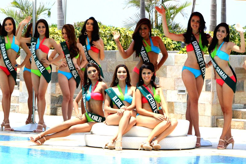 Candidates pose for photos during the Miss Philippines-Earth presentation in Paranaque City, the Philippines, on April 22, 2014. In observance of Earth Day,