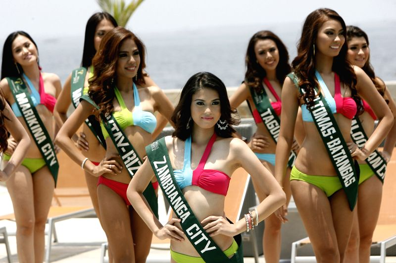 Candidates pose during the Miss Philippines-Earth presentation in Paranaque City, the Philippines, on April 22, 2014. In observance of Earth Day, 51 ...
