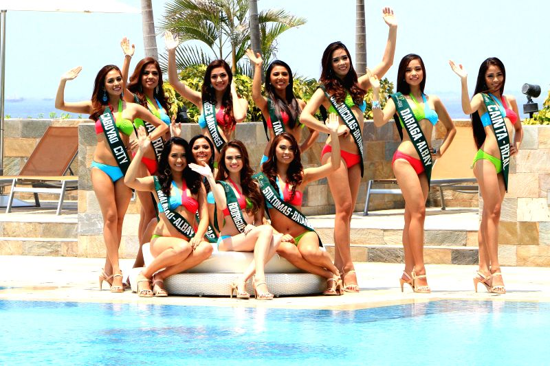 Candidates wave their hands during the Miss Philippines-Earth presentation in Paranaque City, the Philippines, on April 22, 2014. In observance of Earth ...