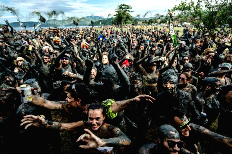 People covered in mud participate in the 29th Bloco da Lama's Carnival, in Parati City, west of Rio de Janeiro, Brazil, on Feb. 16, 2015. (Xinhua/Cristiano ...