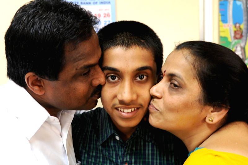 Parents greeting SSLC topper Sudeendra, who is the topper in the Karnataka SSLC examination of this year (622/625) , in Bangalore on Monday 6th of May 2013.