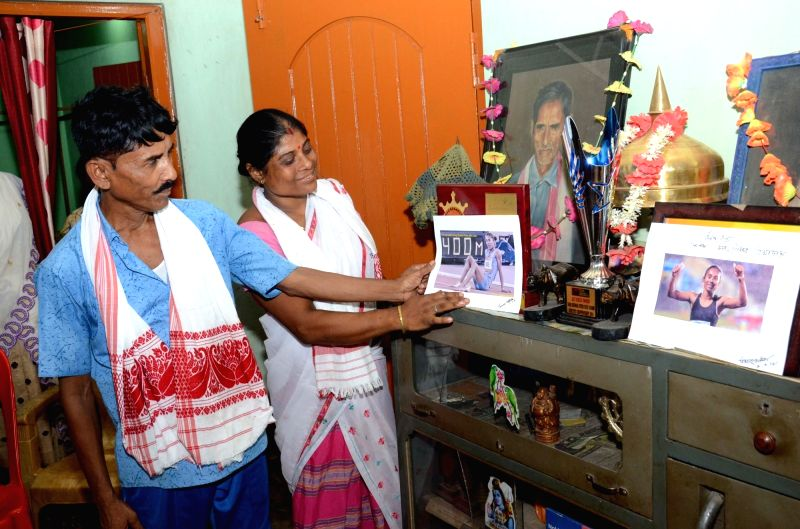 Parents of Hima Das who created history by becoming the first Indian athlete to win a gold at an IAAF event, at their home in Kandhulimari village near Dhing in Assam's Nagaon district, on ...
