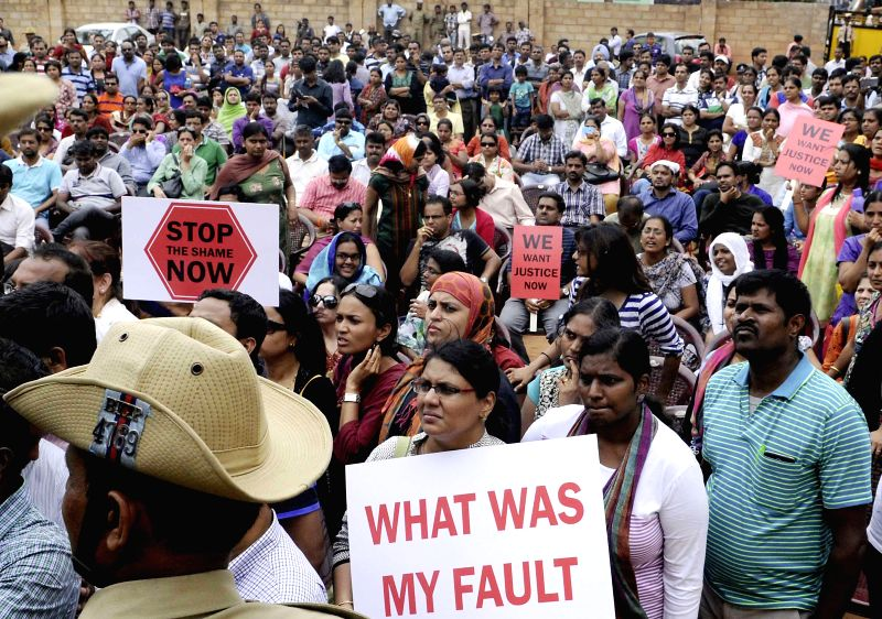 Parents of the students of a private school demonstrate in front of the school to protest against alleged rape of a 6-year-old student in Bangalore on July 17, 2014.