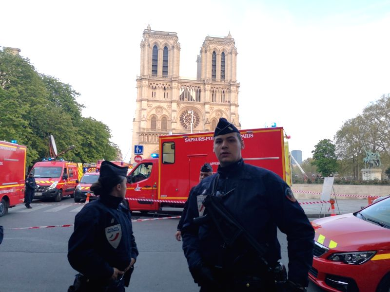 PARIS, April 15, 2019 (Xinhua) -- Rescuers gather near the Notre Dame Cathedral in central Paris, capital of France, on April 15, 2019. A blaze broke out on Monday afternoon at the Notre Dame Cathedral in central Paris where firefighters were still f