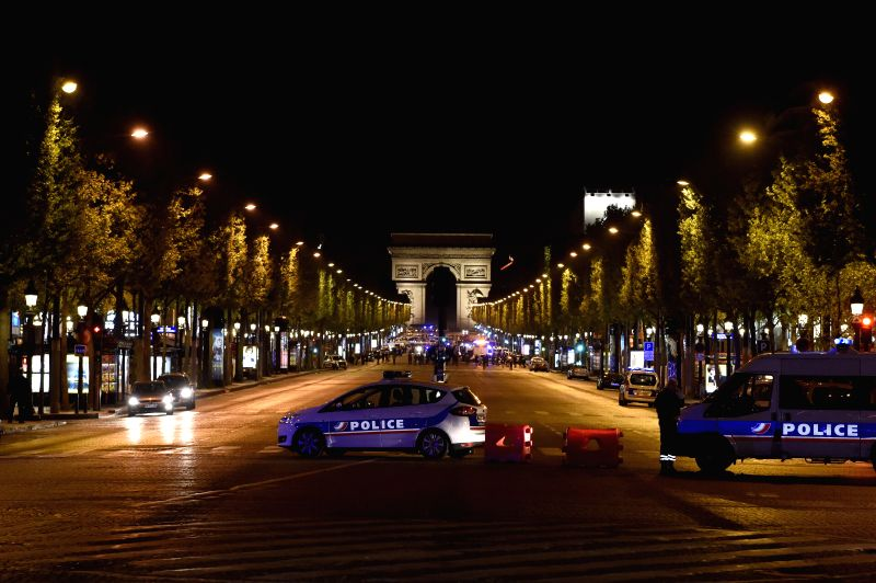 PARIS, April 20, 2017 - Police vehicles block the Champs Elysees shopping street in Paris, France on April 20, 2017. One policeman was killed, and another severely injured in a shooting incident ...