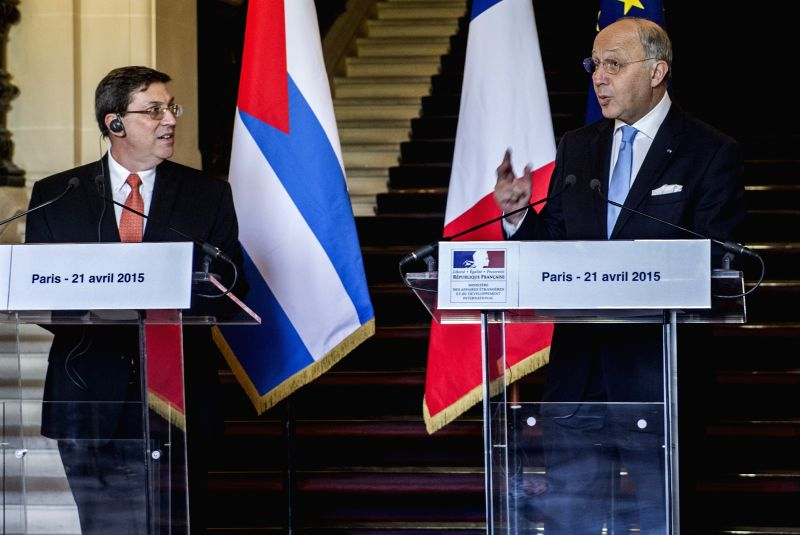 French Foreign Minister Laurent Fabius(R) and Cuban Foreign Minister Bruno Rodriguez Parrilla attend a press conference in Paris, France, on April 21, 2015. Cuban ... - Laurent Fabius