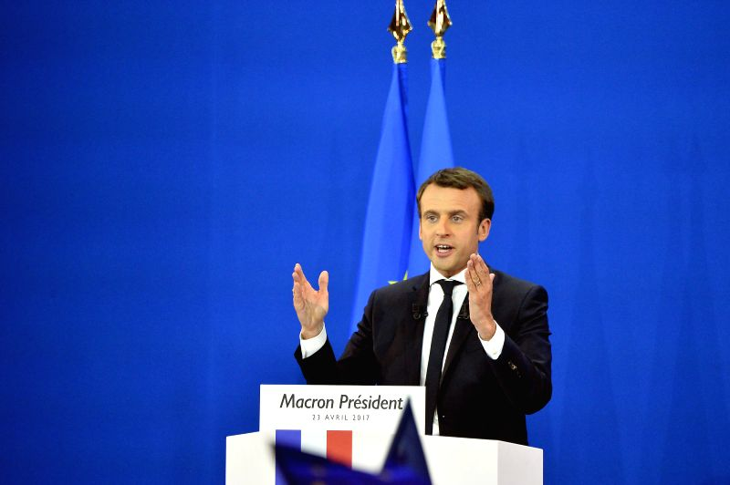 PARIS, April 23, 2017 - Emmanuel Macron, French presidential candidate for the On the Move (En Marche) movement, delivers a speech at a rally after the first round of French presidential election in ...