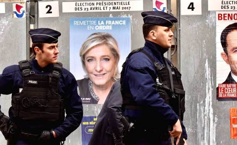 PARIS, April 23, 2017 - Police stand guard during the French presidential election in Paris, France, April 23, 2017. Millions of French voters began casting their ballots in the first round of the ...