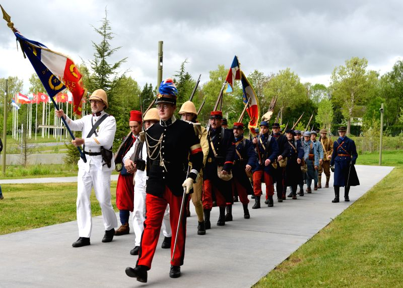 Participants in costumes of World War I army march at the World War I Museum in Meaux, Paris, France, on April 27, 2014. Military enthusiasts attended a reenactment .
